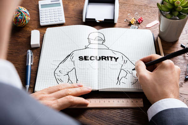 Businessman Drawing Sketch Of Security Guard Stock photo © AndreyPopov