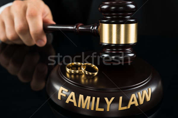 Judges' Hand Hitting Gavel With Golden Rings Stock photo © AndreyPopov