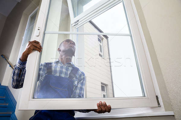 Handyman Installing Window Stock photo © AndreyPopov