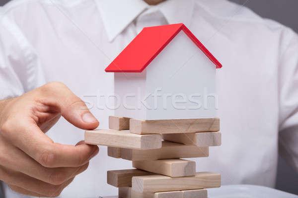 Businessman Balancing Property Sector Stock photo © AndreyPopov