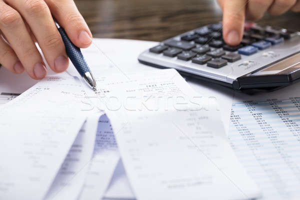Businessperson Calculating Receipt Stock photo © AndreyPopov
