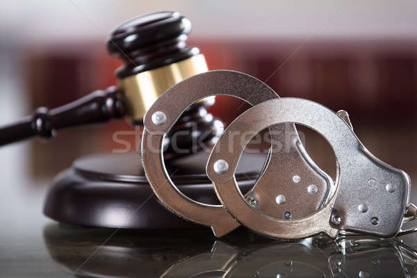 Close-up Of Handcuffs And Gavel Stock photo © AndreyPopov