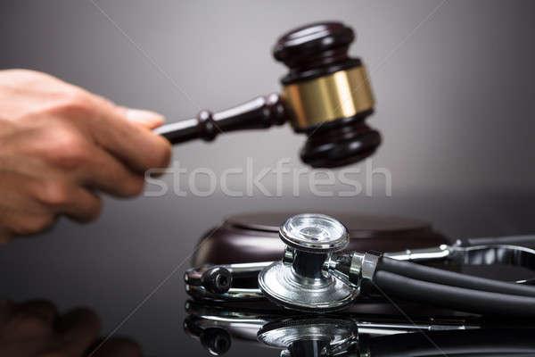 Judge's Hand Striking Gavel Stock photo © AndreyPopov