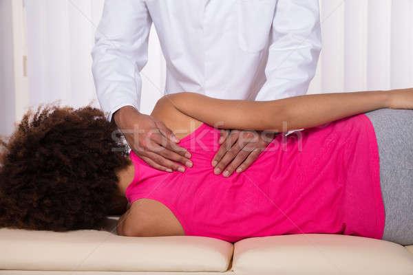 Női beteg hát masszázs hátsó nézet fiatal Stock fotó © AndreyPopov