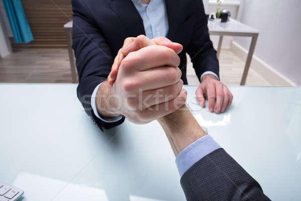 Twee zakenlieden arm worstelen bureau Stockfoto © AndreyPopov