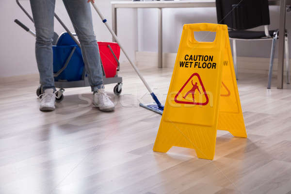 Close-up Of Yellow Wet Floor Caution Sign Stock photo © AndreyPopov