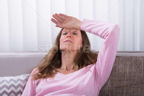 épuisé femme détente canapé maturité Photo stock © AndreyPopov