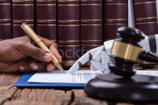 Robotic Hand Assisting A Person For Signing Document Stock photo © AndreyPopov