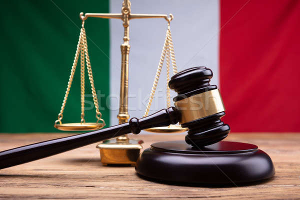 Italian Flag Behind Justice Scale And Mallet Stock photo © AndreyPopov