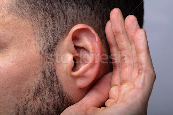 Close-up Of A Man Trying To Hear Stock photo © AndreyPopov