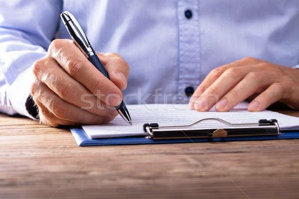 бизнесмен подписания договор стороны документы Сток-фото © AndreyPopov