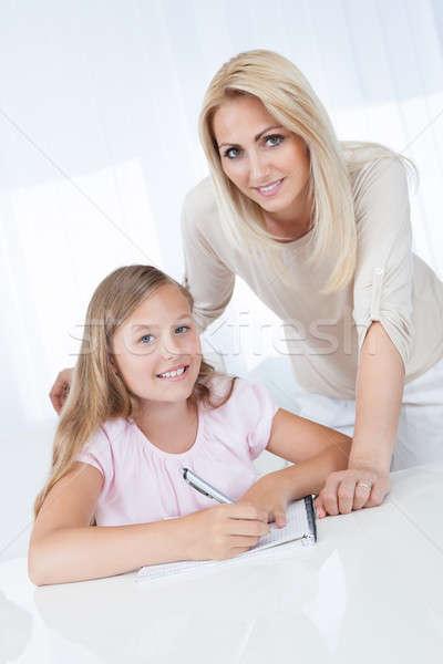 Insegnante aiutare ragazza esercizio scuola famiglia Foto d'archivio © AndreyPopov