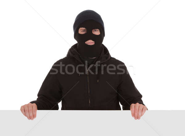 Haydut siyah maske boş kart adam Stok fotoğraf © AndreyPopov