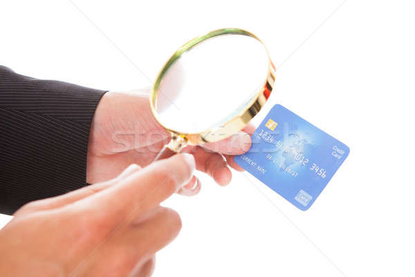 Man Holding Credit Card And Magnifying Glass Stock photo © AndreyPopov