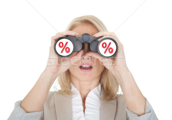 Mujeres mirando venta binoculares aislado blanco Foto stock © AndreyPopov