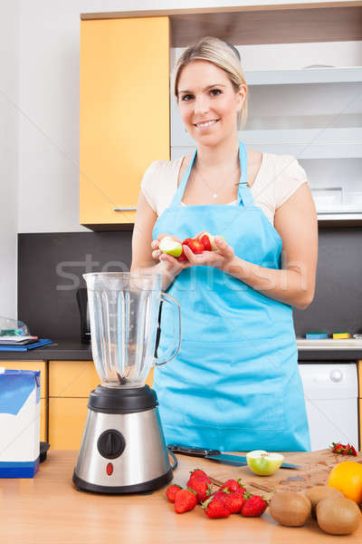Woman Making Strawberry Milkshake Stock photo © AndreyPopov