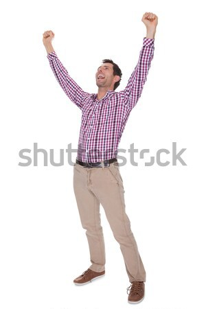 Portrait Of Young Man Cheering Stock photo © AndreyPopov