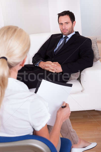 A middle aged smart male executive interviewing Stock photo © AndreyPopov