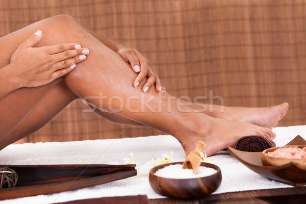 Stock photo: Young Woman Applying Oil Her Legs