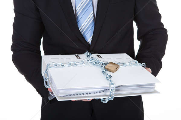 Businessman holding a top secret file Stock photo © AndreyPopov