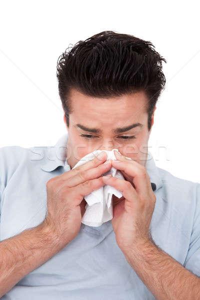 Férfi papírzsebkendő fiatalember orrot fúj fehér orvosi Stock fotó © AndreyPopov