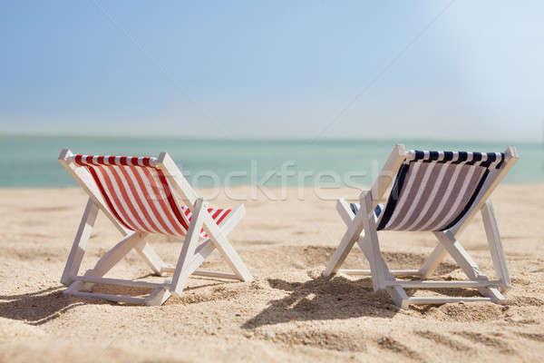 Two Deckchairs On Beach Stock photo © AndreyPopov