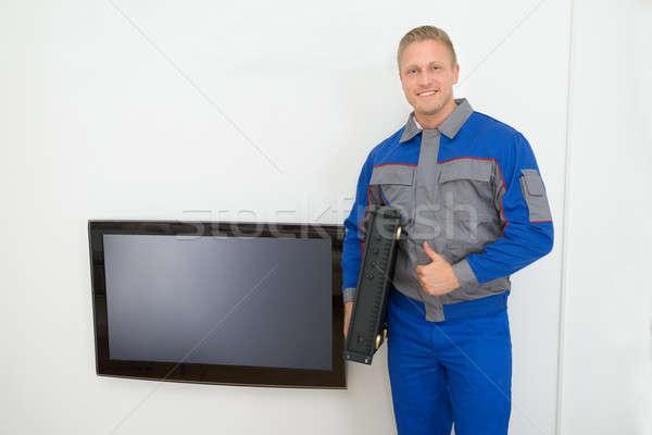 Portrait Of Technician Holding Amplifier Stock photo © AndreyPopov