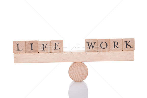 Stock photo: Life And Work Blocks Balancing On Seesaw