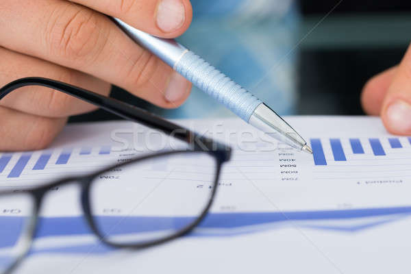 Businessman Holding Pen While Analyzing Bar Graph Stock photo © AndreyPopov
