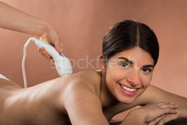 Stock photo: Happy Woman Receiving Epilation Laser Treatment