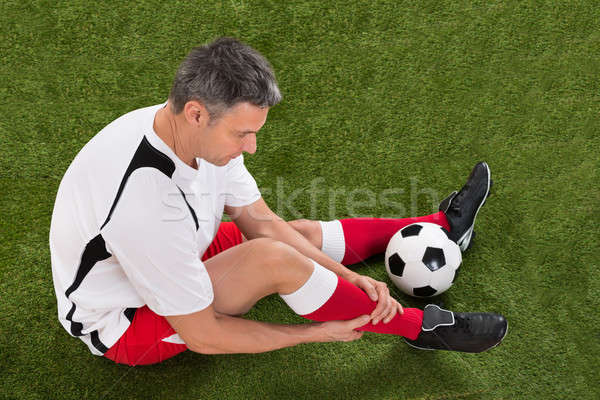 Soccer Player With Injury In Leg Stock photo © AndreyPopov