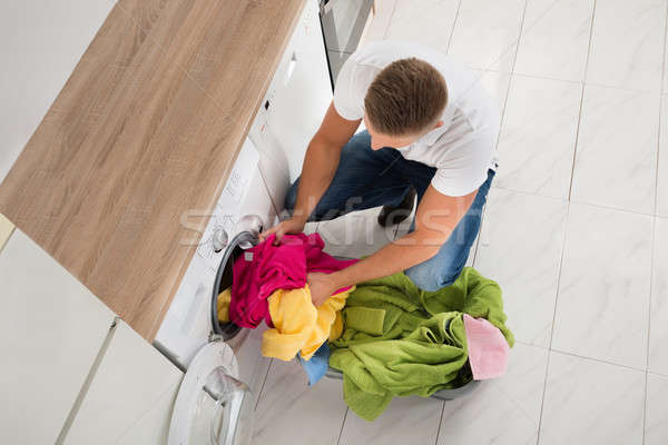 Adam elbise çamaşır makinesi görmek genç Stok fotoğraf © AndreyPopov