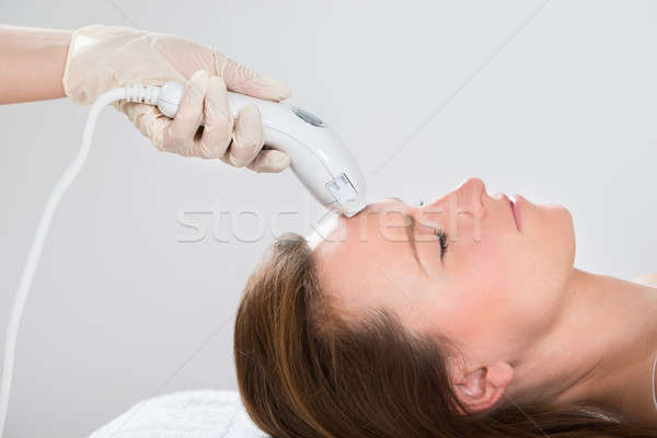 Woman Receiving Laser Hair Removal Treatment Stock photo © AndreyPopov