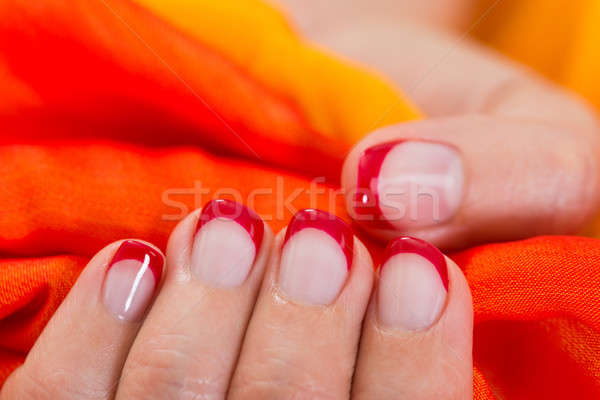 Woman Hands With Nail Varnish Holding Fabric Stock photo © AndreyPopov