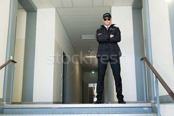 Permanent entrée Homme pliées bras Photo stock © AndreyPopov