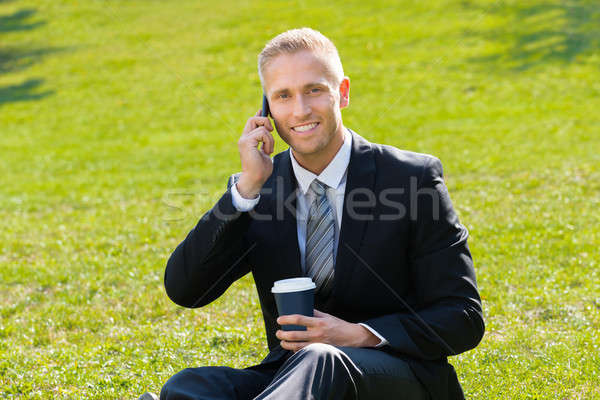 Man Holding Disposal Cup In Hand Talking On Cellphone Stock photo © AndreyPopov