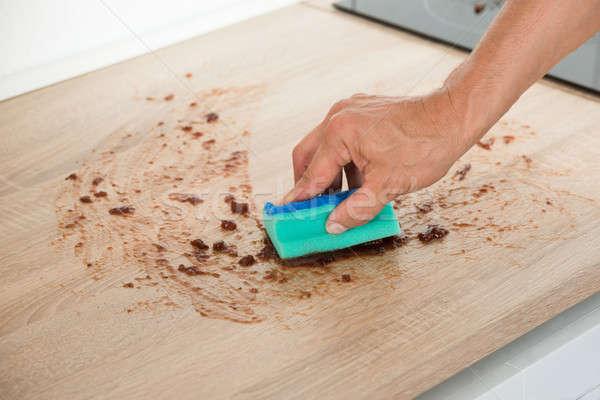 Férfi takarítás konyhapult szivacs kép kéz Stock fotó © AndreyPopov