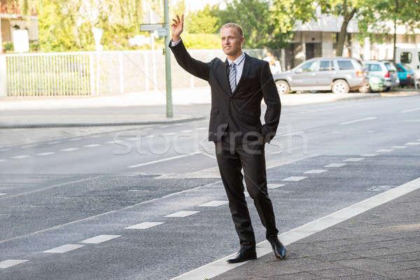 üzletember hív taxi fiatal utca út Stock fotó © AndreyPopov