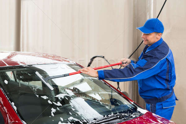 Worker Washing Windshield Of Car At Service Station Stock photo © AndreyPopov