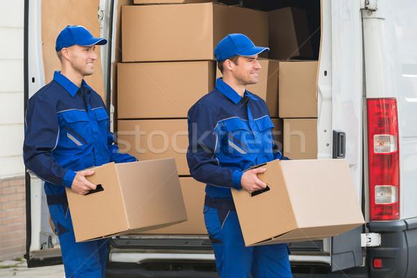 Stock fotó: Házhozszállítás · férfiak · hordoz · karton · dobozok · mosolyog