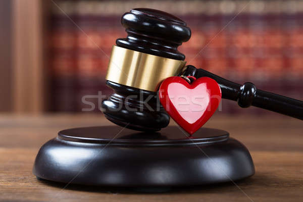 Stock photo: Mallet And Heart On Table In Courtroom