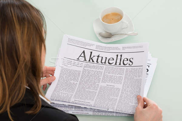 Stock photo: Close-up Of Businesswoman Reading Newspaper