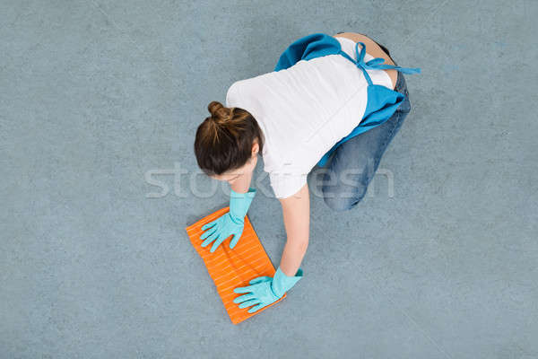 Female Janitor Mopping Floor With Duster Stock photo © AndreyPopov