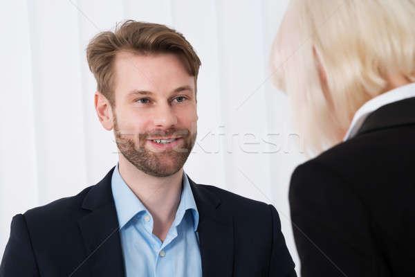 Zwei Geschäftsleute Gespräch jungen Büro glücklich Stock foto © AndreyPopov