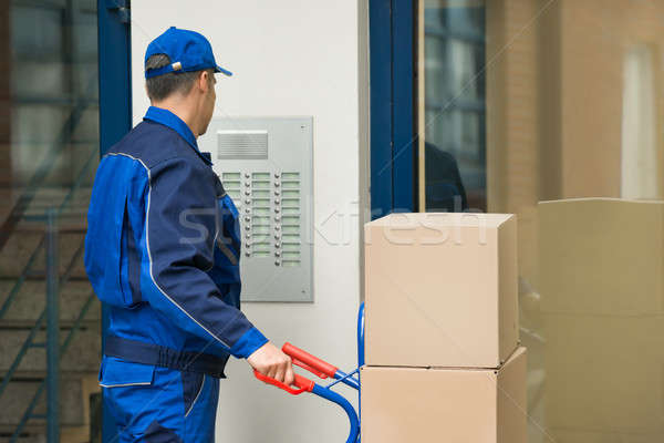 Delivery Man With Trolley Using Security To Enter Building Stock photo © AndreyPopov