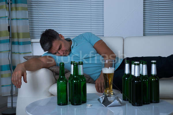 Drunken Man Taking A Nap On Sofa Stock photo © AndreyPopov