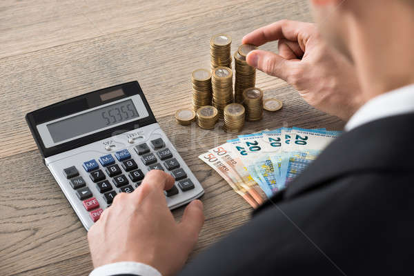 Close-up Of A Businessman Calculating Profit Stock photo © AndreyPopov