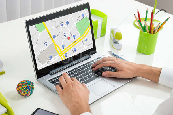 Person Using GPS Map On Laptop Stock photo © AndreyPopov