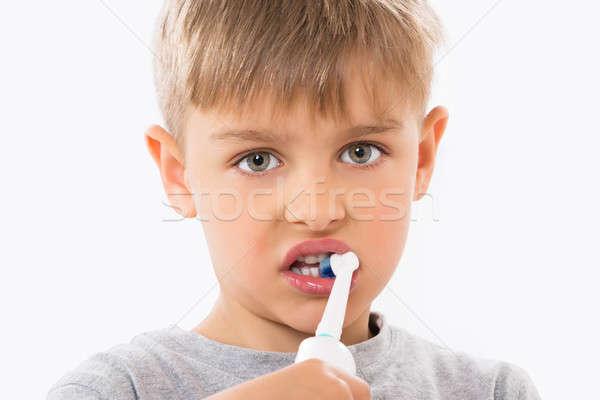 Közelkép fiú fogmosás elektromos fogkefe orvosi Stock fotó © AndreyPopov