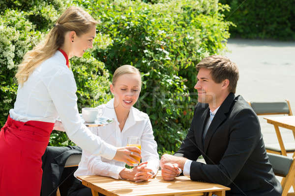 Waitress Serving Glass Of Juice To Businesspeople Stock photo © AndreyPopov